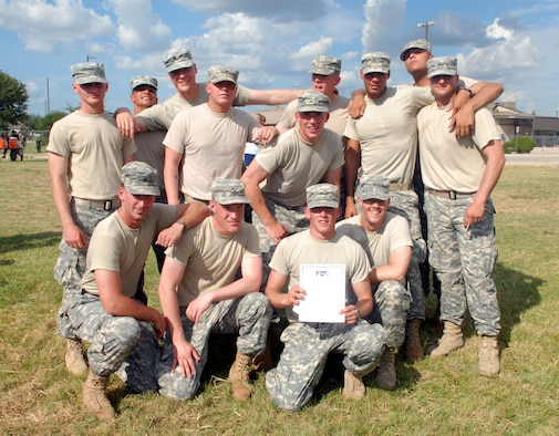 The Little Rascals, a team from the 344th Military Intelligence Battalion, pose after winning the CFC Fire Truck Pull with a time of 26.52 seconds. (U.S. Air Force photo by Staff Sgt. Angela Malek)
