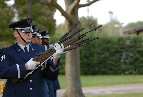 Staff Sgt. Shaun Eby, an Airman from the 100th Logistics Readiness Squadron and RAF Mildenhall Honor Guard, performs a 21 gun salute along with six other honor guard members as part of a Retreat ceremony during the annual Prisoner of War/Missing in Action week of remembrance, Sept. 21, 2007. (U.S. Air Force photo by Tech. Sgt. Tracy L. DeMarco)