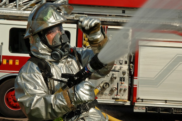 Michael Luba, 435th Civil Engineer Squadron firefighter, performs an operation check on a high-pressure hose during a major accident response exercise on Ramstein Air Base, Germany, Sept. 22. The exercise was based on the collision of a truck carrying ammonia and another carrying radiological waste. This exercise tested the procedures of medical, fire, and law enforcement squadrons stationed at Ramstein as well as organizations from the German community. (U.S. Air Force photo/Airman 1st Class Marc I. Lane)