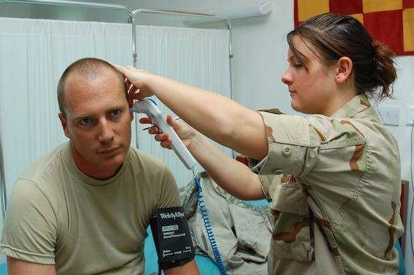 SOUTHWEST ASIA -- Senior Airman Elle Liza Marie Franz, 386th Expeditionary Medical Group medical technician, conducts a vital check on Army patient Sgt. Scott Boomershire at the Contingency Aeromedical Staging Facility here Sept. 24.   The CASF is a 24-hour medical holding and staging facility which averages about 300 patients per month .  (U.S. Air Force photo by Staff Sgt. Tia Schroeder)