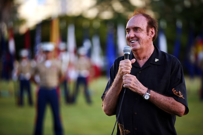 """HONOLULU -- Jim Nabors gives his remarks after being promoted to Honorary Corporal at a sunset promotion at Fort DeRussy Waikiki, Hawaii Sept. 25 on the 43rd anniversary of his TV show's debut, """"Gomer Pyle U.S.M.C.""""  (Official USMC Photo by Cpl. R. Drew Hendricks)"""