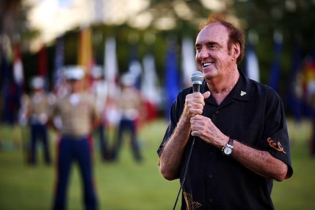 "HONOLULU -- Jim Nabors gives his remarks after being promoted to Honorary Corporal at a sunset promotion at Fort DeRussy Waikiki, Hawaii Sept. 25 on the 43rd anniversary of his TV show's debut, ""Gomer Pyle U.S.M.C.""  (Official USMC Photo by Cpl. R. Drew Hendricks)"