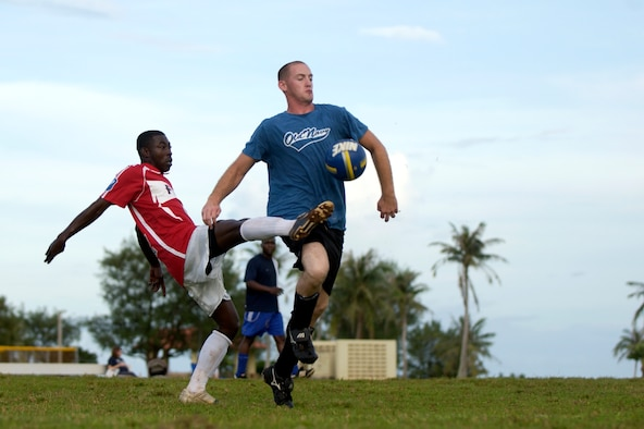 Senior Airman Norman Francis, 36th Civil Engineering Squadron, and Airman 1st Class Christopher Monroe, 36th Communications Squadron, attempt to gain control of the ball during their intramural soccer game, Sept. 25.  The 36th CES won the game against the 36th CS with a resulting score of 8-1. (U.S. Air Force photo/Senior Airman Miranda Moorer)