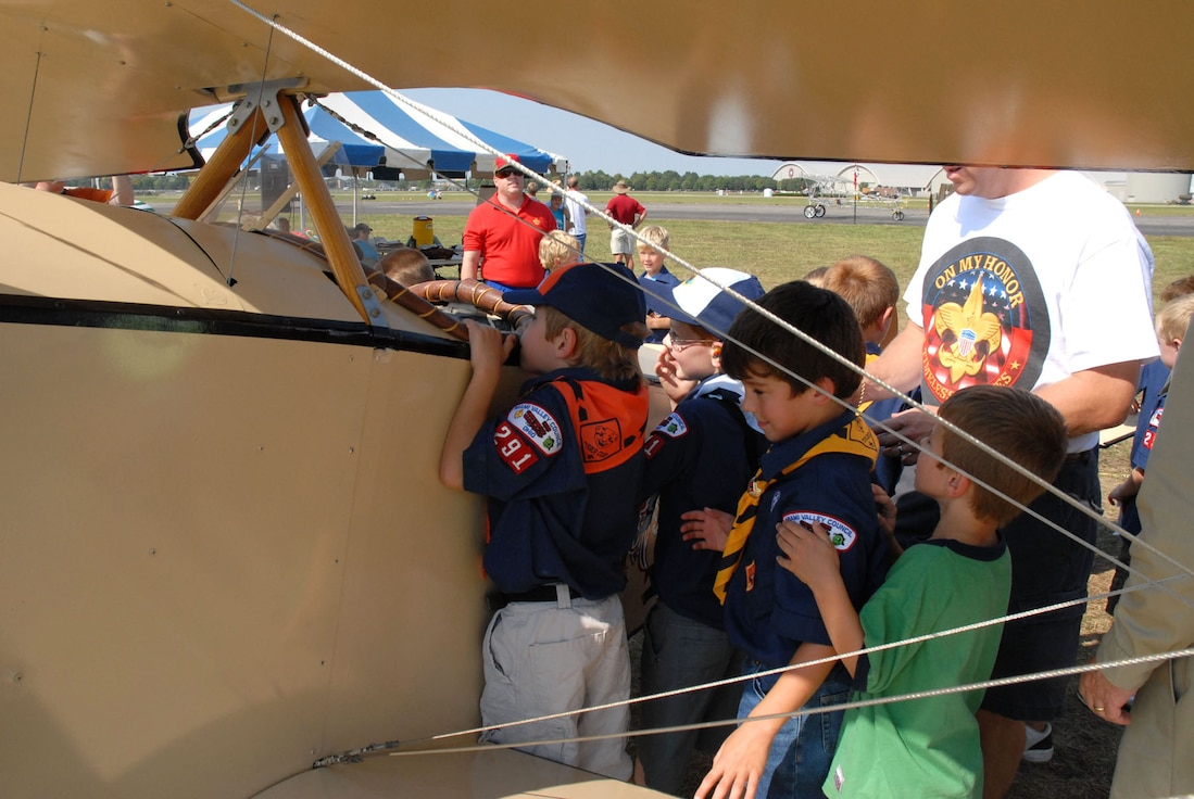A group of Boy Scouts get a closer look inside one of the aircraft during the 2007 Dawn Patrol Rendezvous World War I Fly-In at the National Museum of the United States Air Force. (U.S. Air Force photo)