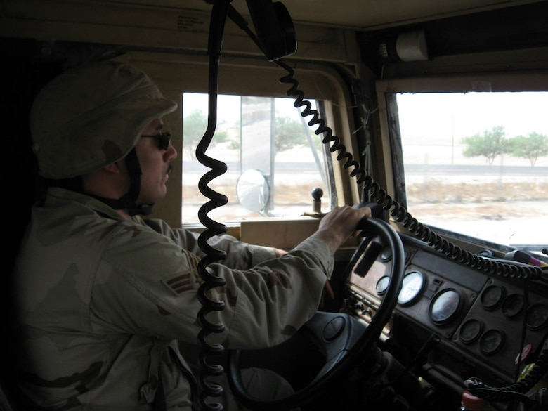 A member of an Air Force Medium Truck Detachment drives during a convoy mission. During a 210-day period, these Airmen complete more than 180 convoys, put 2.5 million convoy miles on the road and encounter more than 40 improvised explosive devices and small arms fire. (U.S Air Force photo)