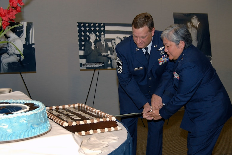 Brig. Gen. Susan Mashiko, MILSATCOM Wing Commander, and Chief Master Sgt. Mark Rafferty cut a birthday cake at Los Angeles AFB's celebration in honor of the Air Force's 60th Anniversary, Sept. 18. The celebration was held in the Gordon Conference Center. (Photo by Joe Juarez)