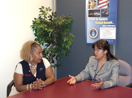 Darlene Oliver, assistant front-end manager at the Wright-Patterson Air Force Base Commissary, and Simone Koram, sexual assault response coordinator, discuss the ways in which the commissary can help spread the message of preventing sexual assault as well as how people can learn to become good wingmen to each other. The partnership between the local Defense Commissary Agency and the SARC is a first for Air Force bases, according to Koram. (Air Force photo by Iyesha Jenkins)