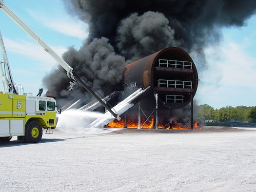 Engineers conduct a JP-8 pool fire using 250 gallons of fuel to test temperature sensors on the New Large Aircraft mockup at Tyndall Air Force Base.  Air Force Research Laboratory, working with the FAA, developed the mockup to research firefighting and rescue techniques in today's larger, multi-deck aircraft. (U.S. Air Force)
