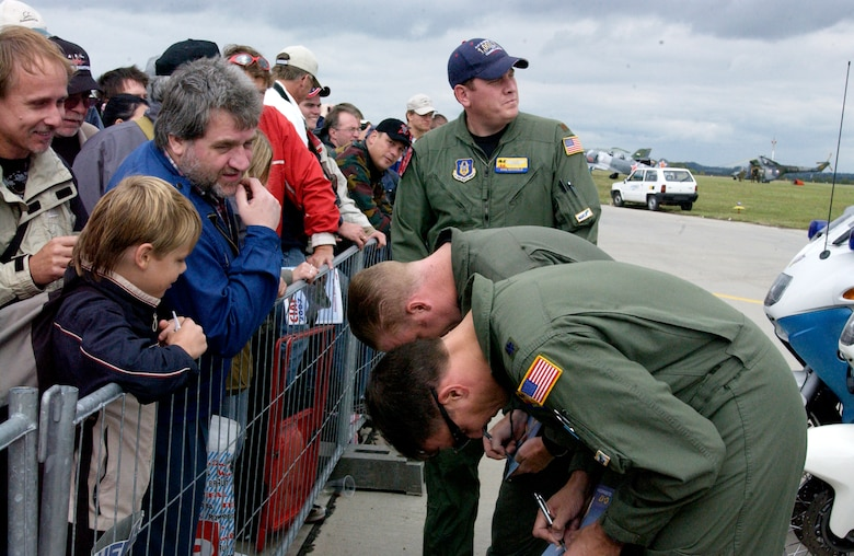 Pilots from Spirit of California from March Air Reserve Base, Calif., sign autographs at the Brno International Air Festival in the Czech Republic. The crew, from the 729th Airlift Squadron, had just completed an aerial demonstration at the air show. (U.S. Air Force photo by Senior Airman David Flaherty)