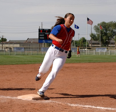 Air Force 2nd Lt. Kristina Dempsey rounds third base and looks to score during the All-Armed Forces Women's Softball Championships held Sept. 18 to 20 at Hill Air Force Base, Utah. For the second time in three years, the Air Force team won the tournament. (U.S. Air Force photo/Alex R. Lloyd)