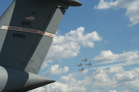 Rickenbacker Air National Guard Base, Columbus, Ohio -- Air Force Thunderbirds aerobatic team fly by the tail of a C-5 Galaxy aircraft from the 445th Airlift Wing from Wright-Patterson AFB, Ohio during the Gathering of Mustangs and Legends air show Friday, September 28, 2007. (U.S. Air Force photo/Maj. Ted Theopolos)