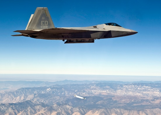 An F-22 Raptor drops a small diameter bomb from its weapons bay during a test mission Sept. 5 over Edwards Air Force Base, Calif. The test marks the first airborne separation of a small diameter bomb from the internal weapons bay of an F-22. (U.S. Air Force photo/Darin Russell)