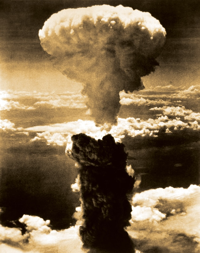 A dense column of smoke rises more than 60,000 feet into the air over the Japanese port of Nagasaki as the result of an atomic bomb, the second ever used in warfare, dropped on the industrial center Aug. 9, 1945, from a B-29 Superfortress.