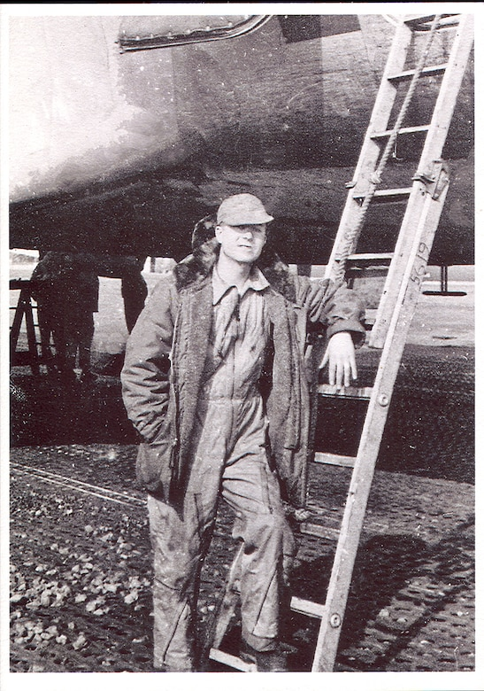 Retired Chief Master Sgt. Wallace Liggett stands next to a C-54 cargo aircraft in the midst of the Berlin Airlift. He was a crew chief and flew 105 missions into Berlin as part of the largest airlift in history at the time. Over the course of his career, he witnessed and took part in many historical events of the Air Force, becoming one of the service's first senior and then chief master sergeants. (courtesy photo)