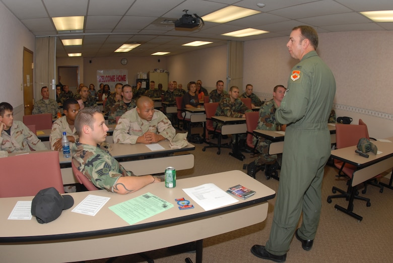 Col. Henry Reed, 56th Fighter Wing vice commander, welcomes home Airmen recently returning from deployment during a post deployment briefing at the Airman and Family Readiness Flight Sept. 20.(photo by Airman 1st Class David Bulkley)