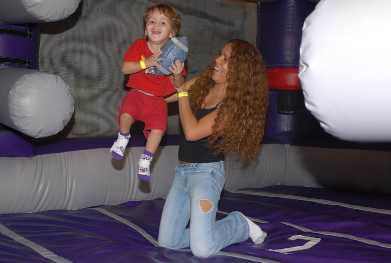 Emilio Munoz, 2, and his mother, Lydia, share a good time at the July 21 Hearts Apart meeting held at Bounce U in Goodyear, Ariz. (photo by Staff Sgt. Ian Dean)