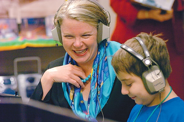 """U.S. Secretary of Education Margaret Spelling visits the Starbase school at Wright Patterson Air Force Base.  Inside the Starbase mission control classroom, Secretary Spelling using call sign """"Starbuck"""" sets with 5th grade student Isaac Satkamp, call sign """"Scarecrow,"""" all in part of Spelling's """"No Child Left Behind"""" tour. (Skywrighter photo by Charles Caperton/U.S. Air Force)"""