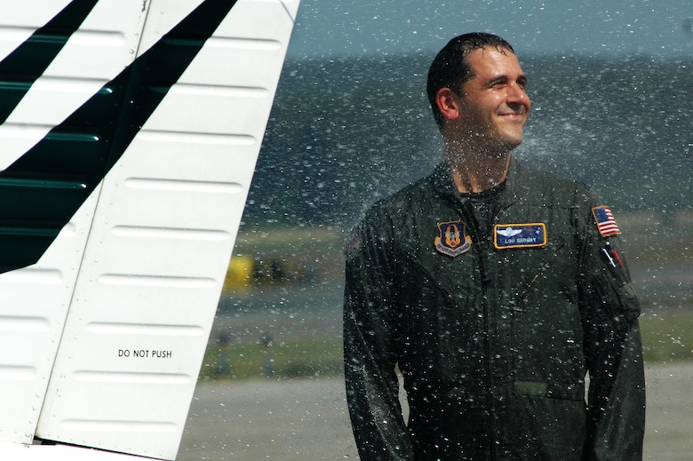 Lt. Col. Lou Shogry enjoys a good soaking amid the New England heat and humidity following his fini flight earlier this summer. Colonel Shogry, former commander of the 337th Airlift Squadron, is now the Emergency Preparedness Liaison Officer with the Federal Emergency Management Agency. (US Air Force photo/Senior Airman Michael Lanza )