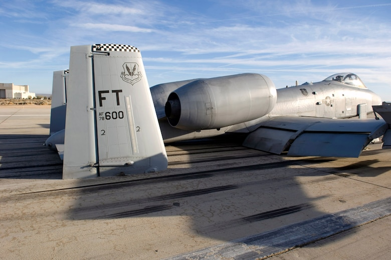 The tail section of an A-10 Thunderbolt II makes direct contact with the runway after making an emergency landing March 25 at Edwards Air Force Base, Calif. The A-10 touched down with its landing gear in the up position after declaring an in-flight emergency. The pilot was not harmed. The aircraft, assigned to the 75th Fighter Squadron at Moody AFB, Ga., was participating in a Green Flag sortie out of Nellis AFB, Nev. (U.S. Air Force photo/Brad White)