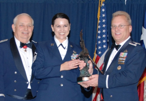 Maj. Gen. Allen Dehnert, Commander of the Texas Air National Guard, and LtCol Randy Johnson, Chief of Recruiting and Retention for the National Guard Bureau present Master Sgt. Cindy Matzen with the Unit Career Advisor of the year award for  2007.  Matzen of the 209th Weather Flight at Camp Mabry in Austin, was selected for the award from among her UCA peers throughout the state and recognized during the Recruiting and Retention conference held in Corpus Chirsti in February.