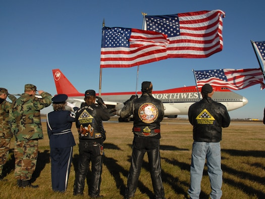 N.D. Patriot Guard Riders salute a plane at Hector Field in Fargo N.D. as 300 World War II veterans depart for Washington DC to view the WWII memorial