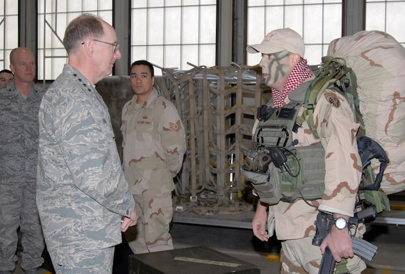 Capt. David Andrews, 21st Medical Support Squadron Logistics Flight commander, talks with Gen. C. Robert Kehler, Air Force Space Command commander, about his deployment to Afghanistan during the general's visit March 28. (U.S. Air Force photo/Roberta McDonald)