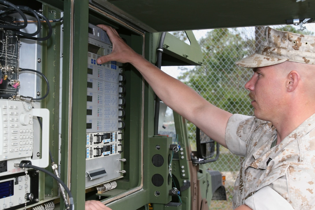 Staff Sgt. Matthew Opperman, with Service Company, 8th Communications Battalion, II Marine Expeditionary Force, works with a Phoenix satellite terminal during Phoenix course practical application for the section here March 10 to April 11.  The Phoenix, which is much lighter and more mobile than the older satellite terminals, is the Marine Corps' newest satellite system.