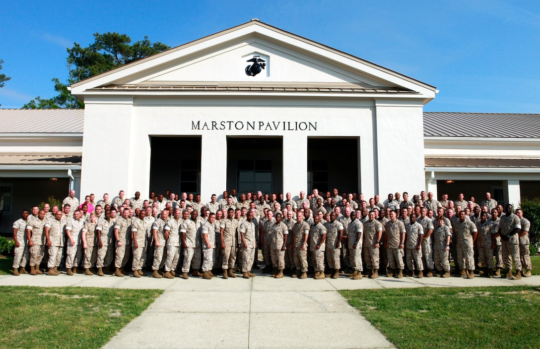 Senior enlisted Marines and sailors throughout Marine Corps Forces Command, pose for a photo during annual Sergeant Major, Master Gunnery Sergeant and Master Chief Symposium at the Marston Pavilion aboard Marine Corps Base Camp Lejeune, N.C., May 3, 2011. The seasoned vets covered a multitude of topics that military personnel and their families deal with on a daily basis. (U.S. Marine Corps photograph by: Cpl. Matthew P. Troyer.)