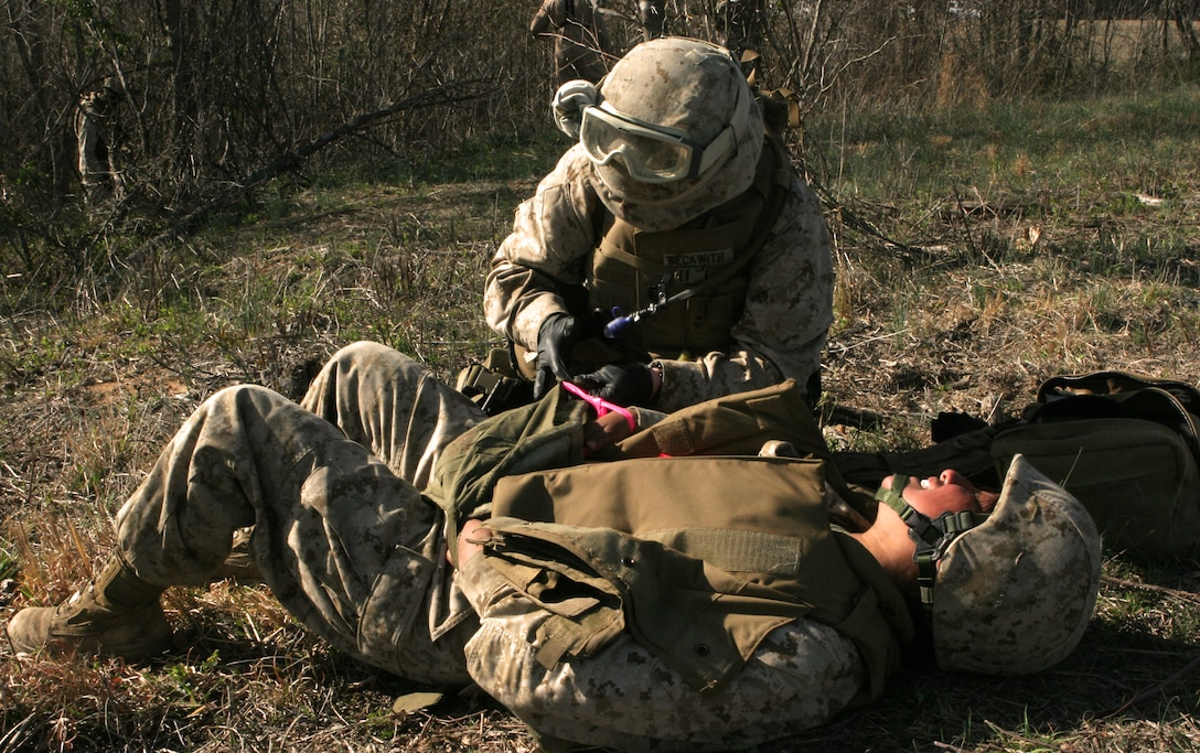 Seaman Nicole M. Beckwith, a corpsman with Combat Logistics Battalion 26, 26th Marine Expeditionary Unit, tends to a simulated casualty during a mass casualty evacuation exercise, April 2, 2008, at Fort Pickett, Va.  The unit's training at Fort Pickett is the first overall MEU exercise in the six month predeployment training cycle.