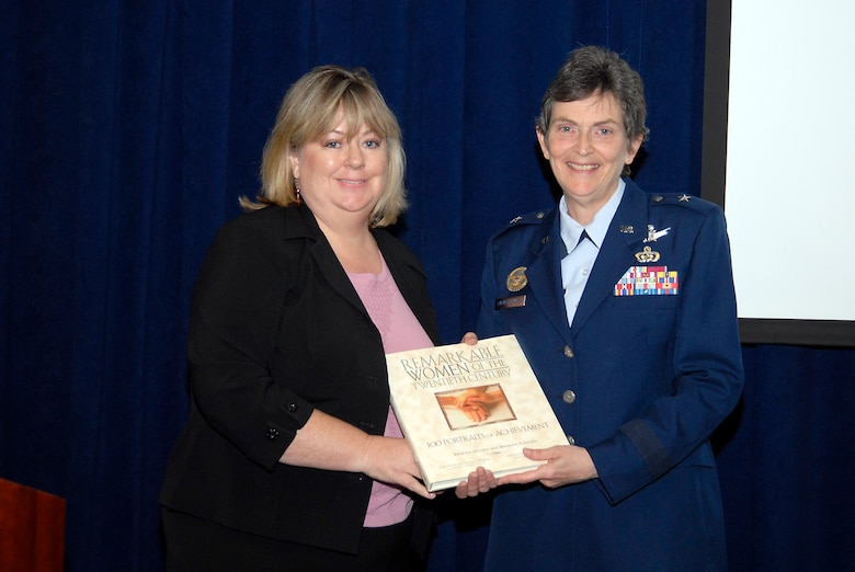 At the conclusion of the Women's History Month luncheon, SMC Vice Commander Brig. Gen. Pawlikowski was presented with a token of appreciation by Los Angeles AFB Federal Women's Program Manager Beverly Campbell.  (Photo by Joe Juarez)