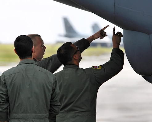 Andersen Air Force Base, Guam -- Aircrew from the 96th Expeditionary Bomb Squadron check out the nose radome of a B-52 Stratofortress before taking off on a training mission at Andersen Air Force Base, Guam. The 96th Expeditionary Bomb Squadron deployed from Barksdale AFB, La. (U.S. Air Force photo/Staff Sgt. Vanessa Valentine)