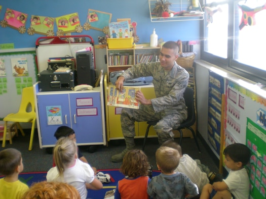 Airman 1st Class Gary Patterson from the 45th Security Forces Squadron reads a book to pre-school children as part of a community involvement effort created by the First Term Airmen Course.  The three and four-year-old children were thrilled to have a visitor come to their class. (U.S. Air Force photo by Tech. Sgt. Lisa Luse')