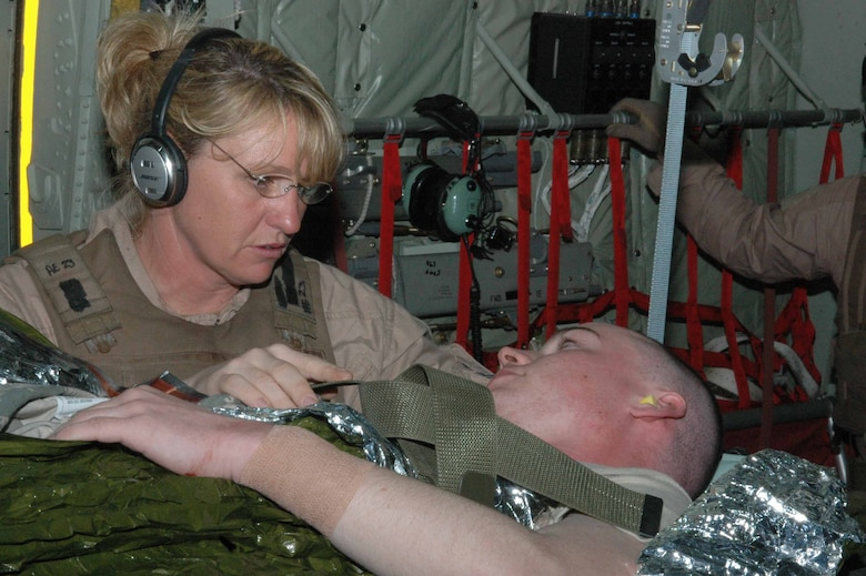 Capt. Lisa Causey, 379th Expeditionary Aeromedical Evacuation Squadron second flight nurse, cares for a litter patient on board a C-130J , April 2, 2008. As an Air National Guard member deployed from the 183rd Aeromedical Evacuation Squadron in Jackson, Miss., she, along with four other medical specialists and a team of pilots and loadmasters, made a 15-hour flight to four cities in Iraq and one air base in the Middle East. They airlifted 19 patients, 16 of whom were ambulatory, to the Persian Gulf, where most of the patients were transferred to a C-17 headed for Germany. (U.S. Air Force photo by Senior Airman Carolyn Viss)