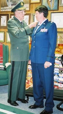 Retired Lt. Col. Otmar E. Stephens, Jr. pins his oak leaf clusters on daughter, Lt. Col. Maggie Stephens to commemorate her recent promotion.