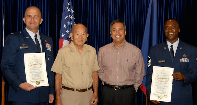Governor Felix P. Camacho presents Lt. Col. Peter Ridilla, 36th Civil Engineer Squadron commander and Master Sgt. Fenton Fitzgerald, also from the 36th CES, with the Governor's Gauhan Award on March 27 at the Governor's Complex in Haganta. Given by the people of Guam, the award recognizes positive contributions made in communities throughout the island. (U.S. Air Force photo by Airman 1st Class Nichelle Griffiths)