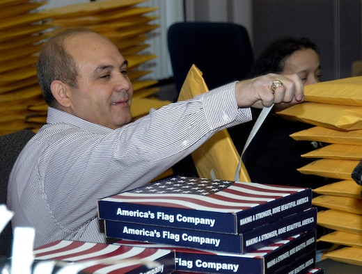 Waleed Sharbini prepares to mail a U.S. flag April 4 at the Air Reserve Personnel Center in Denver. Flags are sent to retiring reservists who request one through ARPC's online retirement application. (U.S. Air Force photo/Mike Molina)