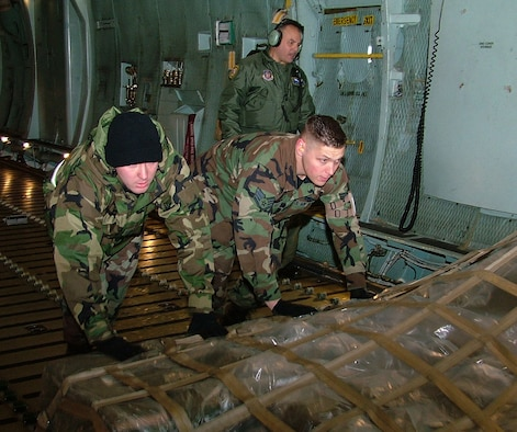GALAXY  LOAD -- Staff Sgts. Glenn W. McAvoy and Anthony D. Marlak, 42nd Aerial Port Squadron, practice loading cargo aboard a C-5 Galaxy during the April A UTA at Westover Air Reserve Base, Mass.  (US Air Force photo/Master Sgt. W.C. Pope)