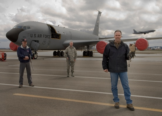 FAIRCHILD AIR FORCE BASE, Wash. – Members of the Bird Aircraft Strike Hazard avoidance program Dave Knutson, contracted falcon trainer and handler, Steven Benson, 92nd Civil Engineer Squadron entomologist, and Tech. Sgt. Joseph Pierce, 92nd Air Refueling Wing flight safety superintendent, pose momentarily for a photo on the airfield here March 1. The BASH program is implemented throughout the Air Force to help reduce the risk for damage to aircraft by local wildlife. (U.S. Air Force photo / Airman 1st Class Joshua Chapman)