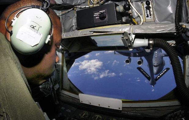 ANDREWS AIR FORCE BASE, Md. -- Tech. Sgt. Willie Cooper, 756th Air Refueling Squadron boom operator, works the control guiding the refueling nozzle on a KC-135 Stratotanker aircraft during a refueling mission over Atlantic City, N.J., March 15. (U.S. Air Force photo/Bobby Jones)