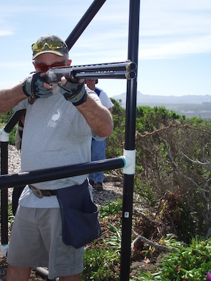 Mike Panella, a member of the Vandeneberg Rod and Gun Club, takes aim at a target during a round of sporting clays. The club offers shooting enthusiasts to try there luck at sporting clay on the second and fourth sunday a month, starting at 9 a.m.(U.S. Air Force Photo)