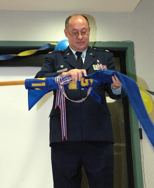 MCGUIRE AIR FORCE BASE, N.J. - Lt. Col. Bruce Adams, final commander of the 714th Aeromedical Evacuation Squadron, furls the squadron flag for the last time.  The Air Force Reserve unit, tasked to provide worldwide in-flight medical aid to the sick and injured, ends 14 years of activation at McGuire Air Force Base. N.J. (U.S. Air Force photo/Master Sgt. Chuck Kramer)