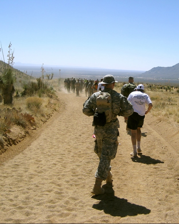 WHITE SANDS MISSILE RANGE, N.M. --  People trudge through the sandy terrain during the 19th annual Bataan Memorial Death March here March 30. The memorial march was in honor of the thousands of servicemembers who were forced to march almost 70 miles with little food and water after surrendering to the Japanese in the Phillippines during World War II. (Courtesy photo)