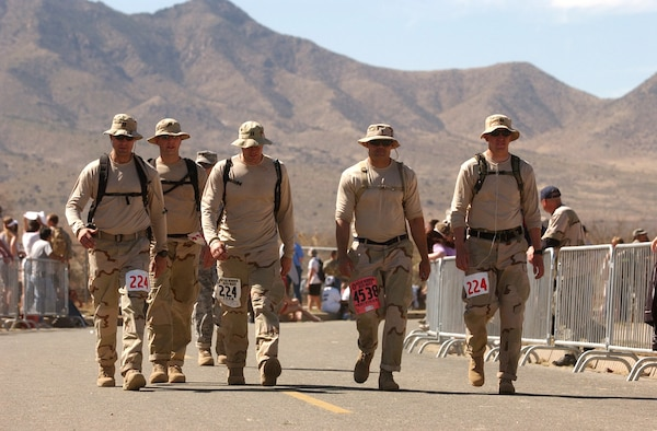WHITE SANDS MISSILE RANGE, N.M. --  (From left) Capt. Ethan Mattox, Capt. Chad Briggs, Capt. Christopher Fernengel, 1st Lt. Anthony Alvarado and Capt. Jon Slaughter get a rare walk on asphalt during the Bataan Memorial Death March on March 30. The 19th annual memorial march was in honor of the servicemembers who were forced to march almost 70 miles with little food and water after surrendering to the Japanese in the Phillippines during World War II. (Courtesy photo)