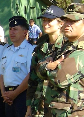 Lt. Col. Cornelia Weiss, center, with Colombian military personnel during a Colombian military joint operations inspection of human rights training in the autumn of 2005. Courtesy photo