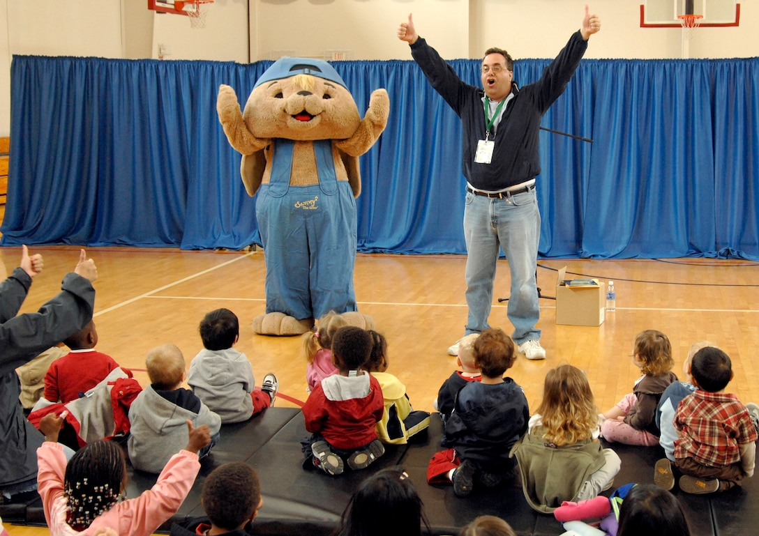 "Sammy ""The Saver"" Rabbit and children's author Sam X. Renick visited Los Angeles AFB to teach children about the importance of both saving money and reading, April 1. The event was sponsored by the Air Force Aid Society and Aerospace Federal Credit Union. Each child who attended received a complimentary music CD and ""It's a Habit, Sammy Rabbit!"" story book. (Photo by Lou Hernandez)"