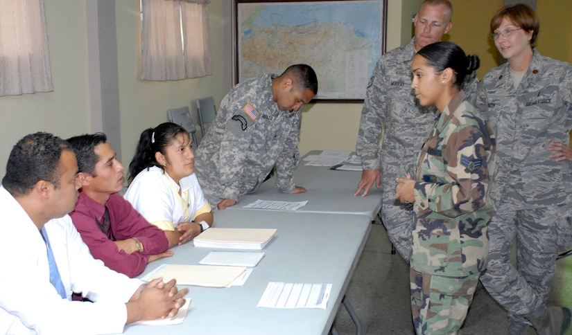 SOTO CANO AIR BASE, Honduras--Joint Task Force-Bravo medical element Air Force personnel Senior Airman Yaritza Liriana, Staff Sgt. Tom Murray, Maj. Regina Paden and MEDEL's Army Staff Sgt. Erik Gonzalez, respond to questions from Honduran medical staff during an information exchange at Hospital Militar Luis Alonso Discua. The exchange was attended by more than 35 medical professionals from several public and private hospitals in the Tegucigalpa region. (U.S. Air Force photo by Tech. Sgt. William Farrow)