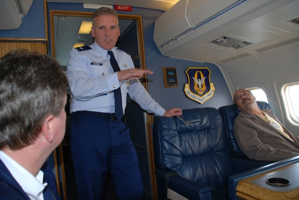 Col. Jay Flournoy, commander of the Air Force Reserve Command's distinguished visitor flying mission in Illinois, explains the role of the C-9C plane.  He and the aircrew provided information about the 932nd Airlift Wing during a recent flight.  Photo/Tech Sgt. Gerald Sonnenberg