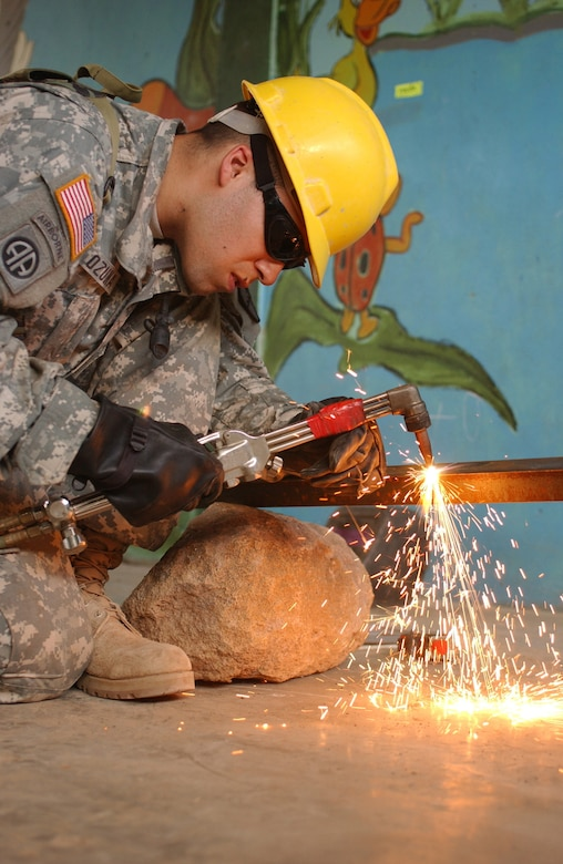 LAS MESAS, Honduras: U.S. Army Reserve welder Sgt Juan M. Ozuna of the 672nd Engineer Company constructs burglar bars for the grade school of this rural village. Soldiers from the 672nd, 756th, and 1430th Engineer Companies are working in Las Mesas during the joint forces training exercise Beyond the Horizon. They will replace the school's doors and windows, repair the roof, and repaint the entire structure, in addition to improving a soccer field on which local children play. Beyond the Horizon provides infrastructure renovation, as well as basic medical and dental care, to areas across this Central American country. (Photo by Sgt. Claude W. Flowers, 304th Public Affairs Detachment.)