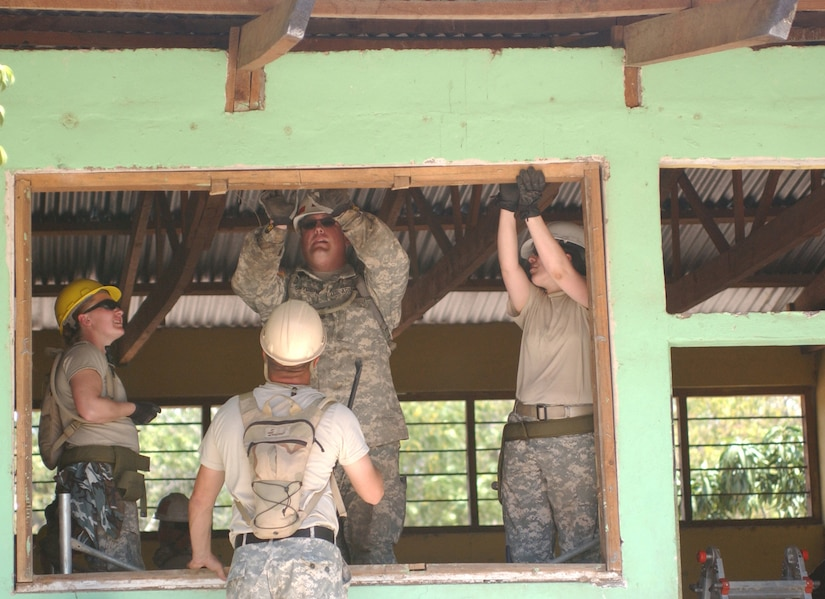 4/1/2008 - LAS MESAS, Honduras - U.S. Army engineers remove a dilapidated schoolhouse window as part of Beyond the Horizon, an exercise that provides infrastructure renovation, as well as basic medical and dental care, to rural areas of this Central American country. Soldiers from the 672nd, 756th, and 1430th Engineer Companies are working at Las Mesas during the joint forces training exercise Beyond the Horizon. They will replace the school's doors and windows, repair the roof, and repaint the entire structure, in addition to improving a soccer field on which local children play. (Photo by Sgt. Claude W. Flowers, 304th Public Affairs Detachment.)
