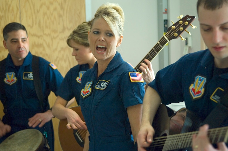 Members of the Air Force Heartland of America Band's Night Wing perform for servicemembers past and present April 5 at the James A. Haley Veterans' Hospital in Tampa, Fla. The band performed throughout the hospital to lift the spirits of military members.  Night Wing is an ensemble of the Heartland of America Band stationed at Offutt Air Force Base, Neb. (U.S. Air Force photo/Staff Sgt. Bennie J. Davis III)